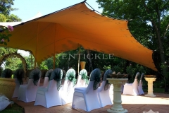 Wedding seating area covered by Tentickle tent