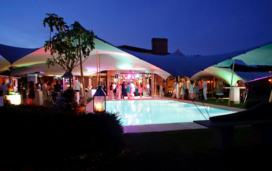 Tentickle Tent Covering a Pool at Night