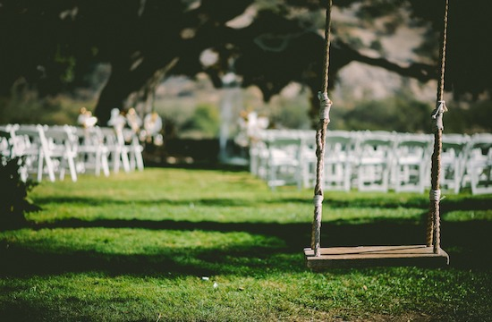 Outdoor wedding scene with swing